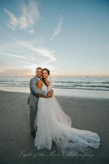 bride and groom at sunset on Clearwater Beach