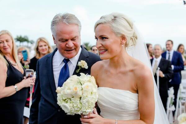 bride walking down the aisle with her father at her Yacht StarShip wedding
