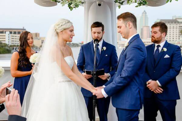 bride and groom exchanging wedding vows on the upper deck of the Yacht StarShip in Tampa