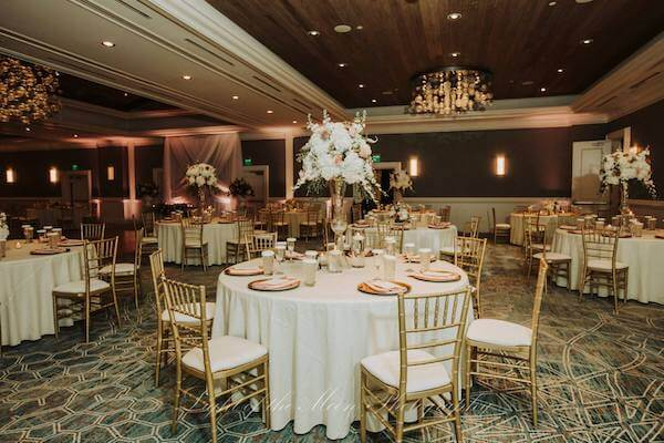 ballroom at the Hyatt Clearwater Beach set in gold, white and antique pink