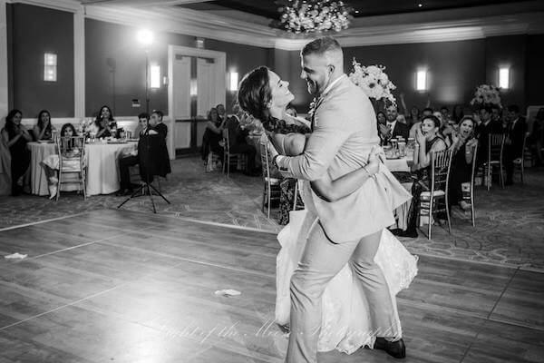 groom dipping his bride during their first dance