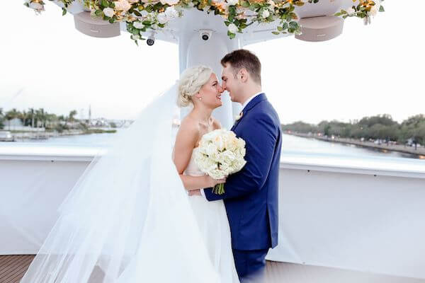 bride and groom on the bow of the Yacht StarShip in Tampa