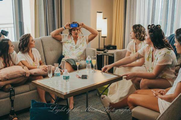 bridal party playing games before getting ready for the wedding