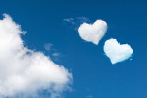 blue skies with two heart shaped clouds