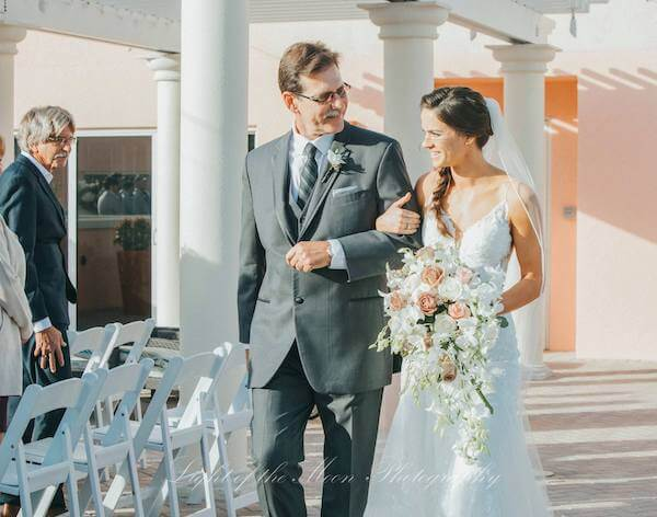 father walking his daughter down the aisle at the Hyatt Clearwater Beach