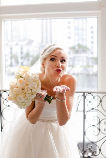 adorable bride blowing kisses at the camera