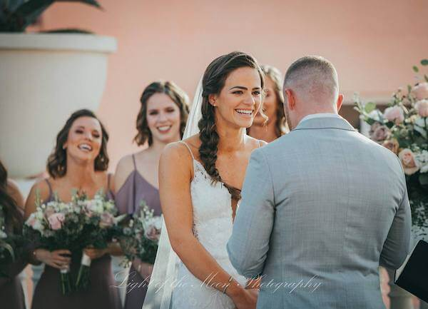bride smiling as she exchanges her wedding vows at the Hyatt Clearwater Beach