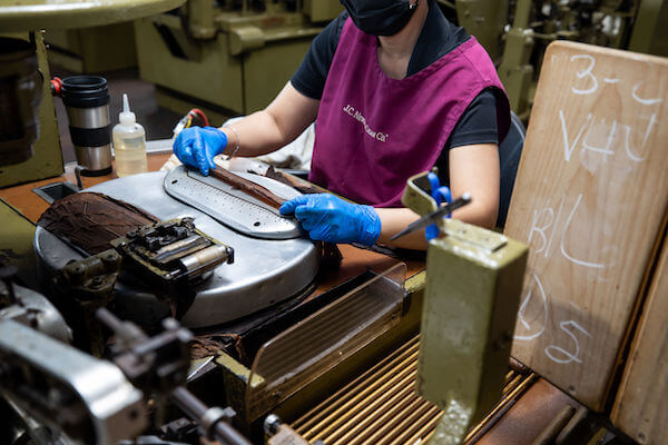 machine assisted cigar roller at the JC Newman Cigar Co factory in Ybor City, Tampa Florida