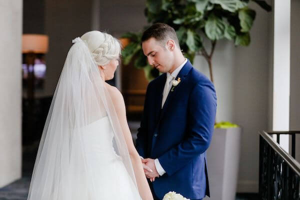 bride and groom holding hands after their first look