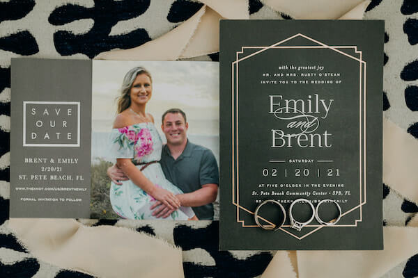 flat lay photograph of a couple's save the date wedding invitation and rings