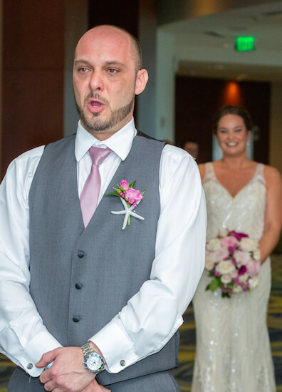 broom taking a deep breath before Turing around to see his bride for the first time