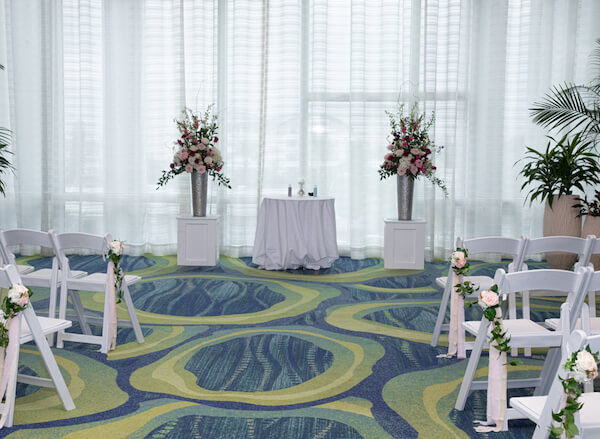 Indoor wedding ceremony at the opal sands resort was the couple's plan b