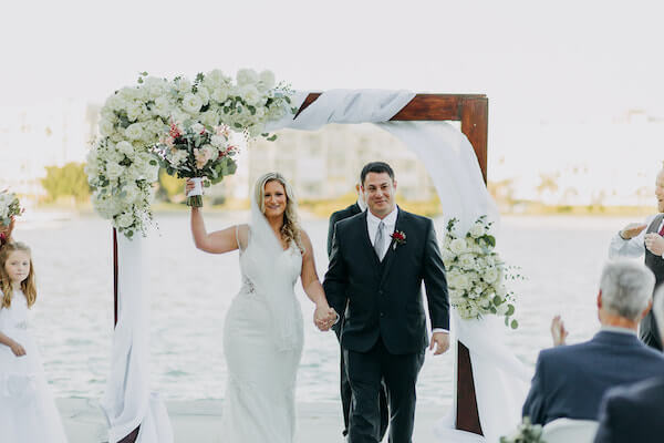 just married! Excited bride and groom after their st Pete beach wedding
