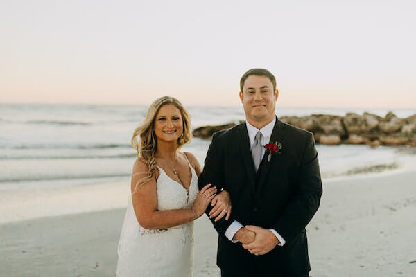 bride and groom at sunset on st Pete beach