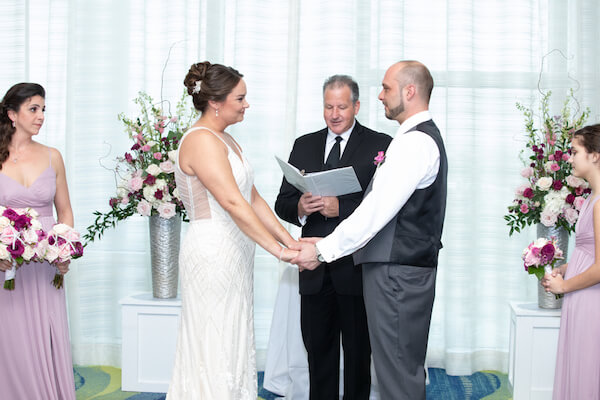 bride and groom exchanging wedding vows during their Opal Sands wedding ceremony