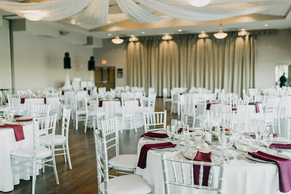 Boca Ciega ballroom at St Pete Beach community Center with ceiling drip silver chairs and burgundy napkins