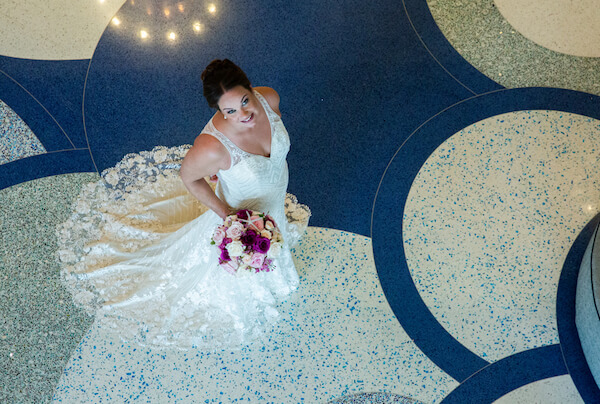 overhead view of a bride on an blue mosaic floor