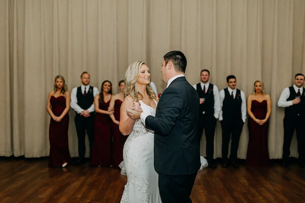 wedding party washes on as newlyweds have their first dance at the St Pete Beach Community Center