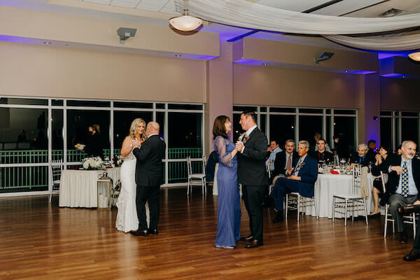 Bride and groom dancing with their parents at the St Pete beach Community Center on Boca Ciega Bay