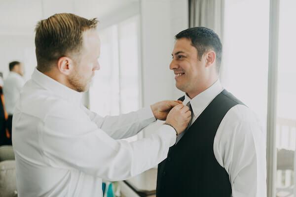 best man adjusting the groom's tie