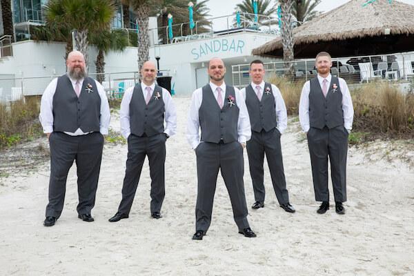 Groom with groomsmen outside the Opal Sands Resort