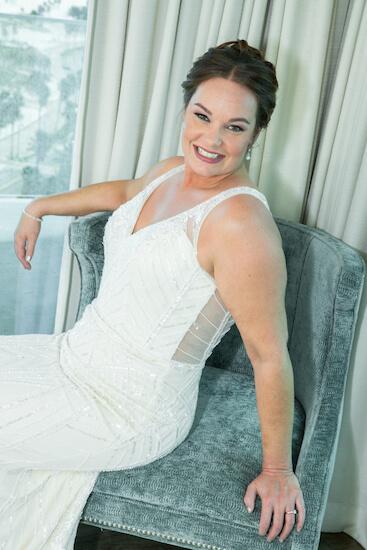 bride posing in her bridal suite before her first look