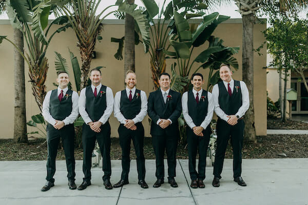 groom and wedding party taking photos at the st Pete beach community center on Boca Ciega bay