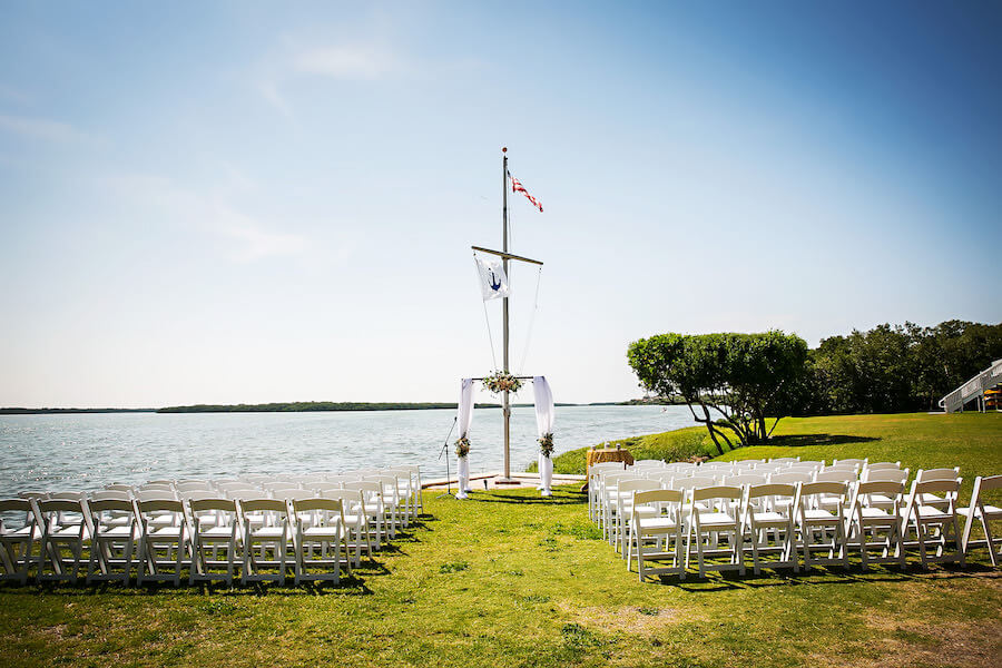 outdoor wedding ceremony at the flag pole of Tampa Bay Watch