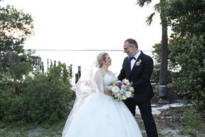 Bride and groom on the waterfront across from the Fenway Hotel in Dunedin Florida