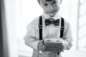 adorable ring bearer holding a ring box