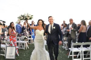 excited bride and groom after their Opal Sands Resort Gulfside wedding ceremony