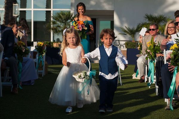 Ring bearer, flower girl and bridesmaid walking down the aisle at the Opal Sands Resort