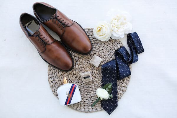 flatly photo of grooms accessories on his wedding day