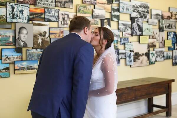 bride and groom kissing after their first look