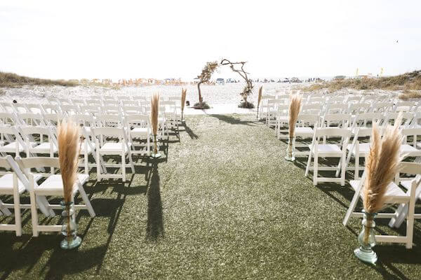 clearwater beach wedding set with beautiful grasses and a driftwood wedding arch