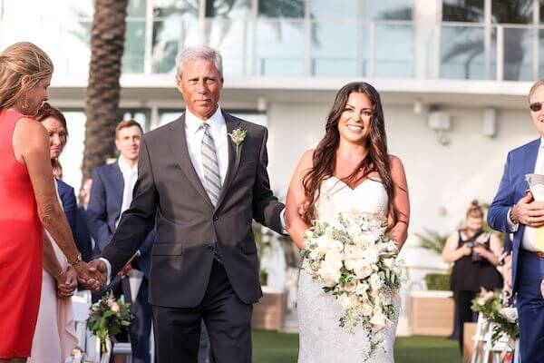 father of the bride escorting his daughter down the aisle at the Opal Sands Resort