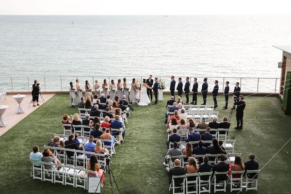 overhead view of a wedding ceremony on the Gulf Lawn at the Opal Sands Resort