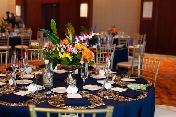 Opal Sands wedding reception with navy-blue linen and bright tropical colors