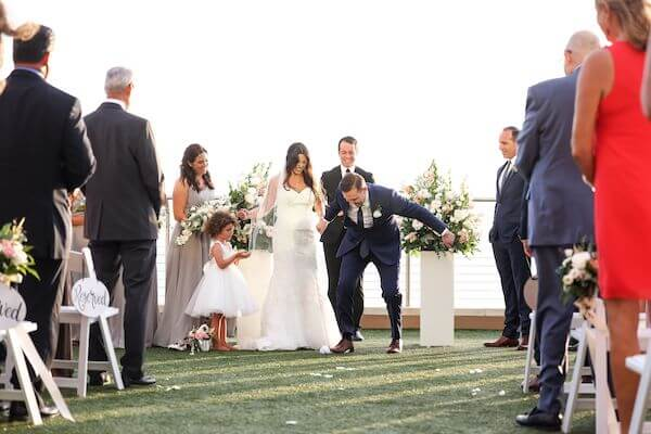 groom stomping on a glass at the end of his wedding ceremony