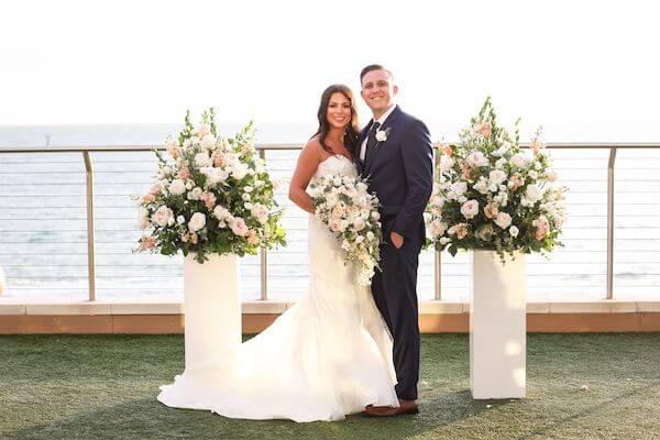newlyweds posing for photos after their wedding ceremony