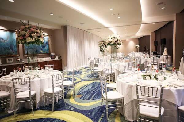 ballroom of the Opal Sands Resort set for wedding reception