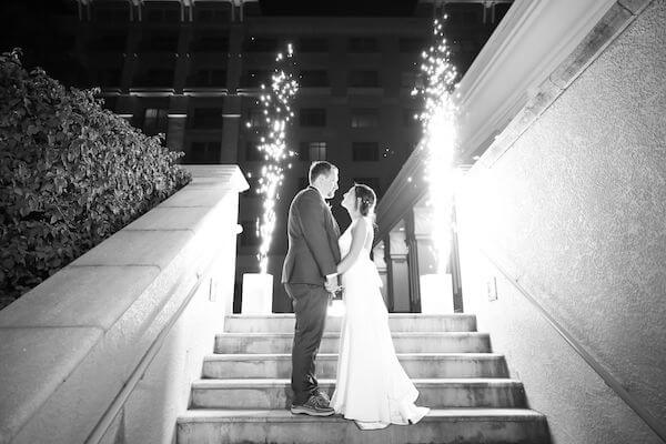 bride and groom in front of a sparkler fountain