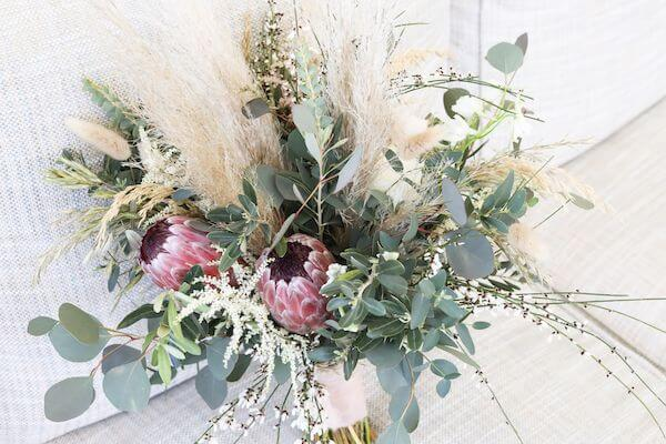 bridal bouquet with greenery, sea grass and proteas