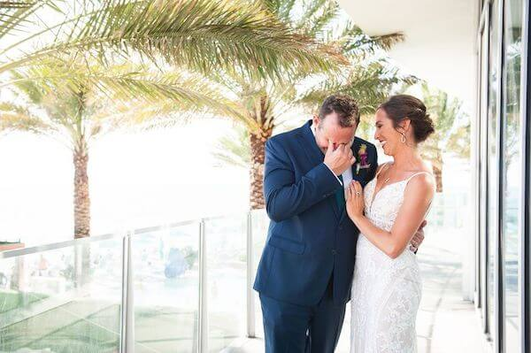 groom breaking into tears after seeing his bride for the first time