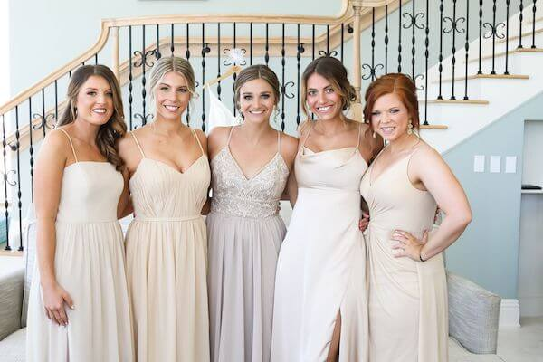 bride with bridal party wearing neutral dresses