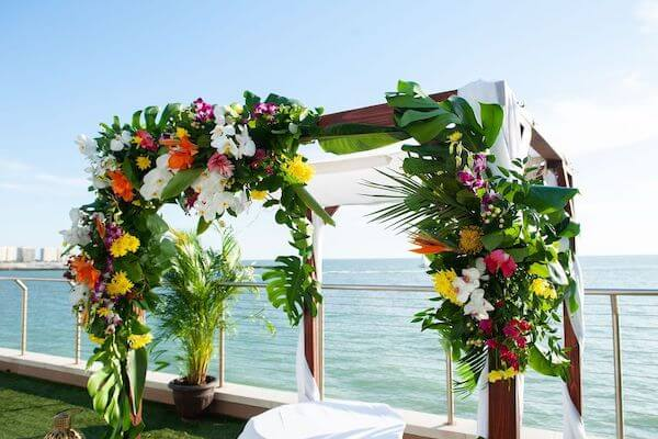 A Chuppah with bright tropical colors overlooking the Gulf of Mexico at the Opal Sands Resort