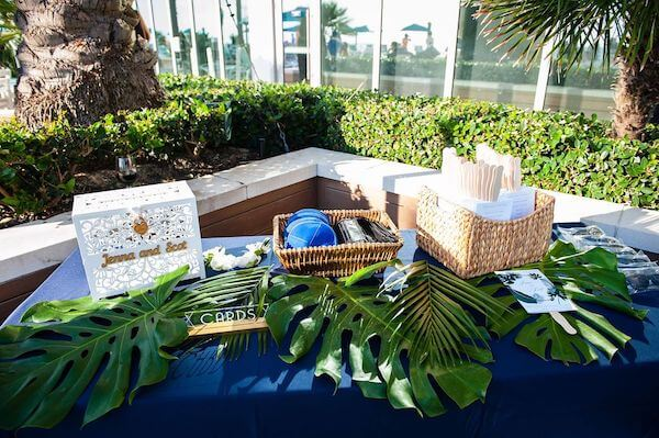 Ceremony table with wedding programs, kipper and card box