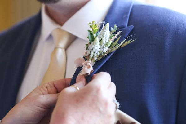beautiful detailed groom's boutonniere