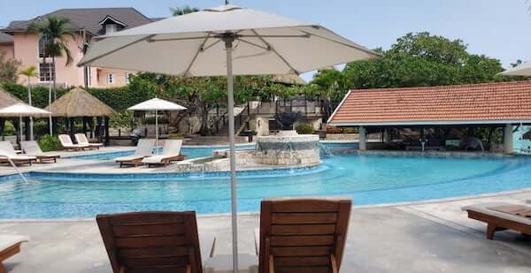 Beautiful pool with umbrellas and private cabanas