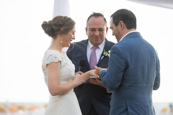Couple exchanging wedding rings at their Clearwater beach wedding
